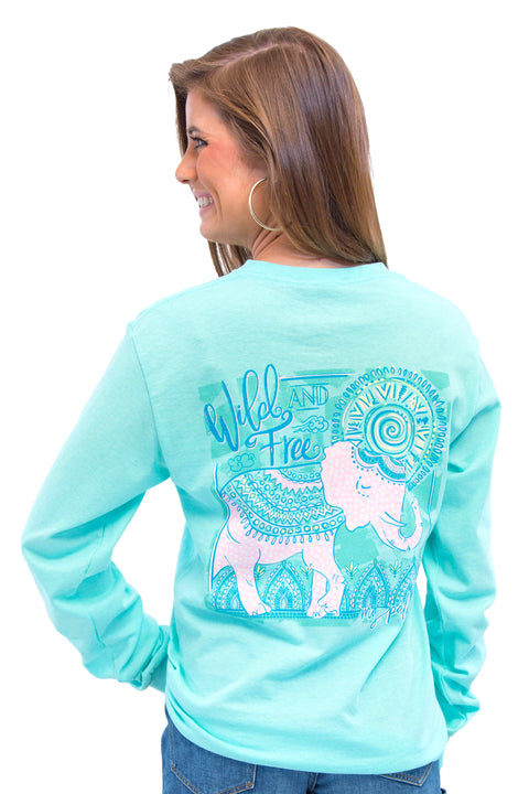 "MG Palmer ""Free to be Wild"" long sleeve tee in Celadon. Picture is of the back of the shirt with a large print of a decorative elephant walking scene."
