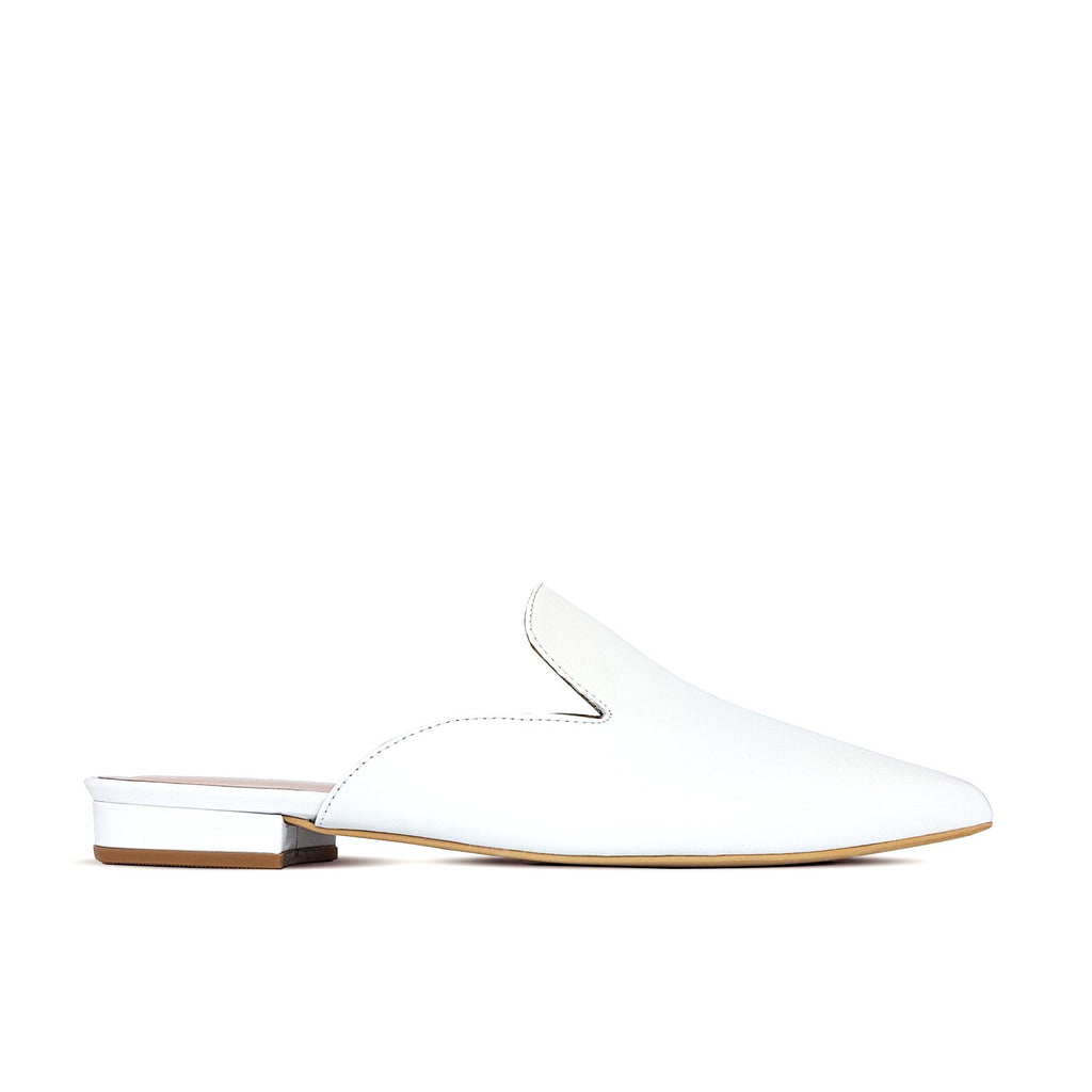 White leather flat mules. Shop online or in our store in Nicosia, Cyprus