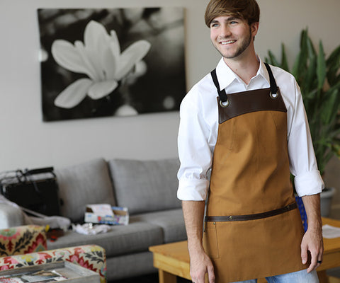 A dude, being a guy, while becoming a man, all while wearing n organic Wescott half bib apron