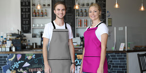 Grey and pink aprons with black straps