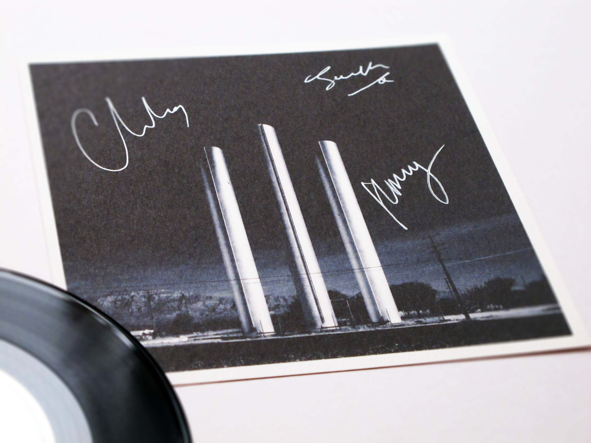 white lies vinyl with autographs