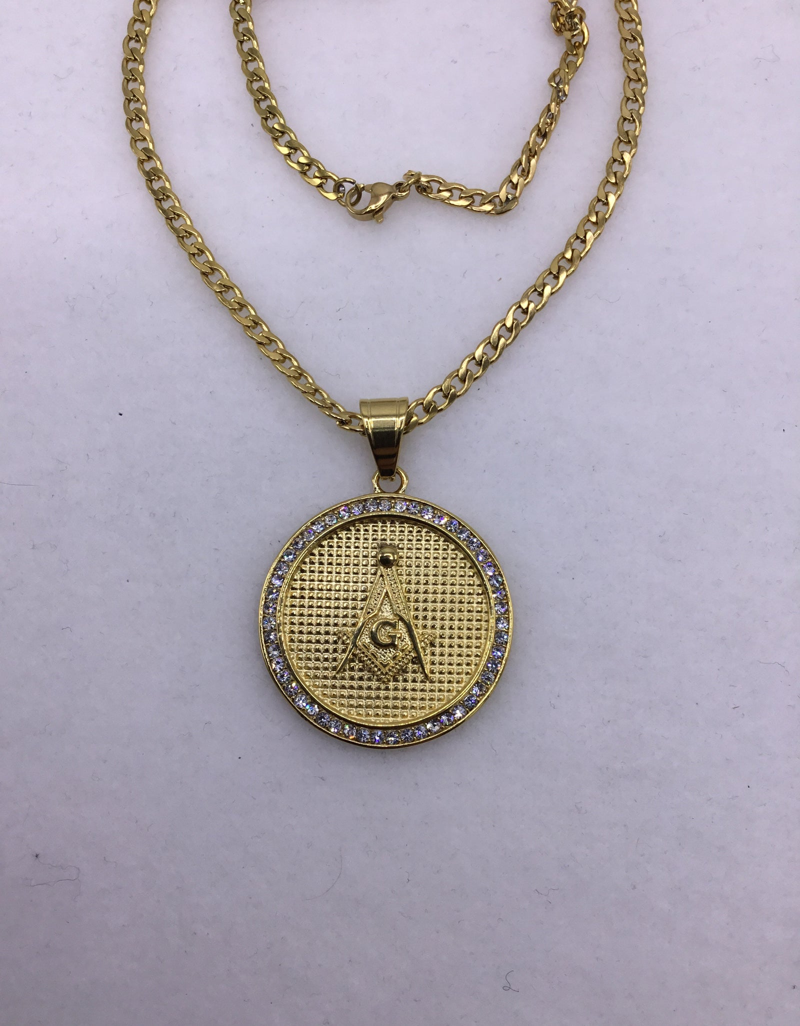 18k gold over stainless steel Medallion with Cubic Zirconia includes Cuban link chain set