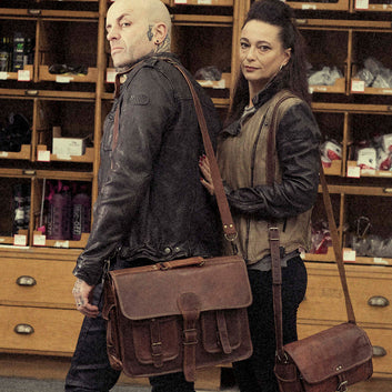 Models with vintage leather briefcase bags