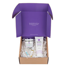 Thistle Farms Bath + Body Gift Set products in open packaging box, front view