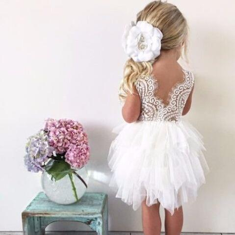 Beautiful lace dress with beading floral pattern on the front of the gown with layered white tutu finish