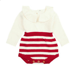 Adorable baby clothes for cooler months. Long sleeve knit romper with ruffled overlay collar and color block red on white with brown buttons.
