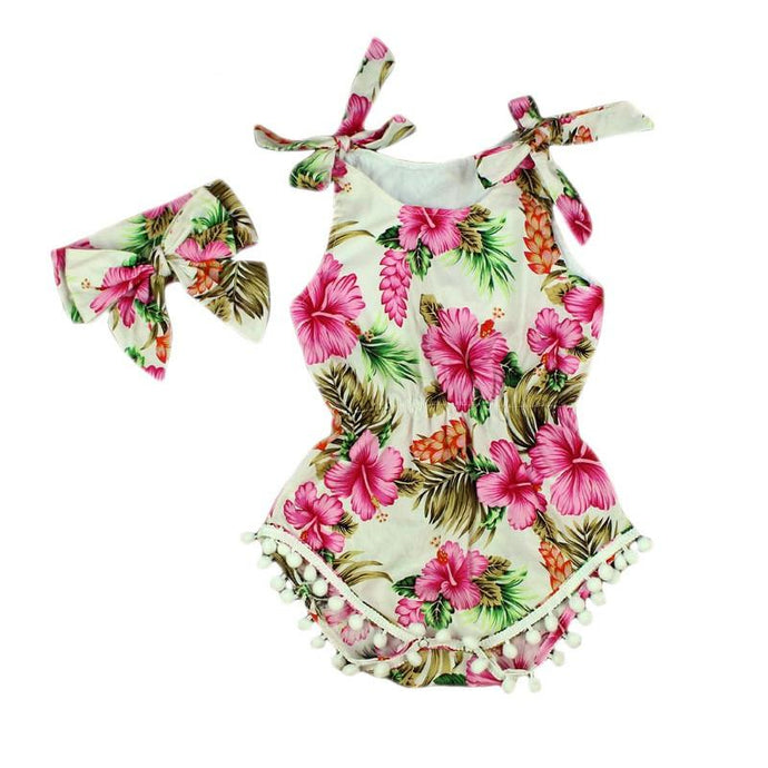 Trendy Toddler Clothes Must Have! Vibrant tropical print romper with tassels and matching headband.