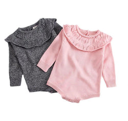 Knitted Baby Romper perfect for Fall and Winter. Available in pink or gray with a ruffled overlay collar and easy button closure.