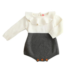 Adorable baby clothes for cooler months. Long sleeve knit romper with ruffled overlay collar and color block gray on white with brown buttons.