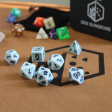 Light blue and white antiqued dice sets from dice dungeons.