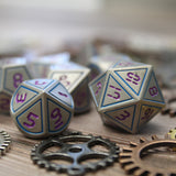 Digital font Blue and Purple metal dice set close-up.