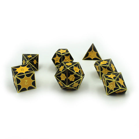 Gold metal dice with enamel inset as dragon scales - enamel is black and yellow.