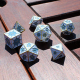 White Dragon Scaled Dice in Sunlight