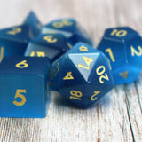 Closeup of Blue Cats Eye Dice Set