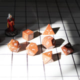 Gemstone Gold Sandstone Dice Set on Table