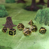 Black and gold metal dice on forest map.