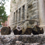 Metal Primordial Gold Dice Set Outside on Stone