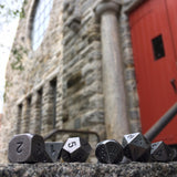 Primordial Silver Dice Set Outside in-front of Church