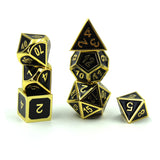 black and gold metal dice for dnd. Stacked.