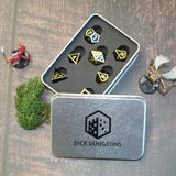 black and gold metal dice in a box.