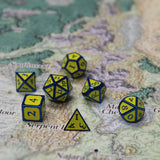 Imperial yellow and blue metal dice on map.