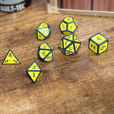 Hero Metal dice (yellow and blue) on table