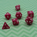 Pearl rose red plastic dice for dungeons and dragons.