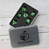 Bright green metal dice in display case box.