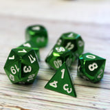 Closup of metal bright green dice set for D&D.