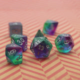 Layered dice set for D&D on red table.