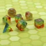 Layered yellow & orange plastic dice set on table.