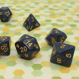 Closeup of deep blue dice with glitter.