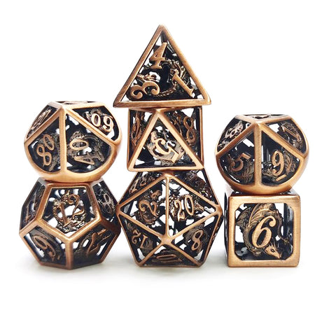 Brass hollow cage dice set with dragon design.
