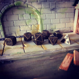 Antique Gold Color Dice Set in Mini Sewer Dungeon
