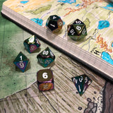 Metal Rainbow Color Dice on Sword Coast Map
