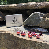 Dice Dungeons red metal dice on stone.