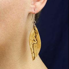 finished pair of spalted wood dangle earrings bing worn