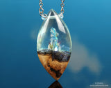 Phantom Crystal Pendant, resin and wood necklace by cut branch