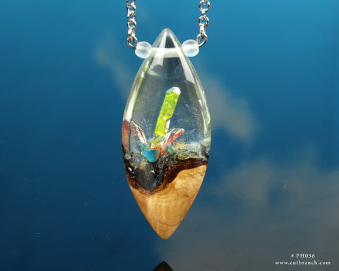 Yellow crystal world trapped inside a resin and wood necklace