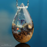 Purple flower resin and wood teardrop pendant