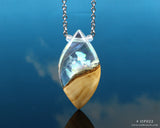 white aurora opal shards trapped in a resin and wood pendant necklace