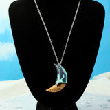 white opal crystal moon resin and wood necklace on a chain