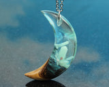 resin and wood crescent moon pendant handmade by cut branch