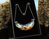 large glow in the dark statement moon pendant in a cut branch jewelry gift box