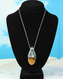 Resin and wood teardrop pendant on an 18 inch chain