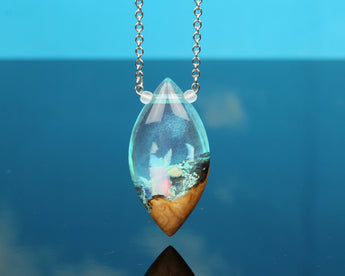 glowing resin and wood necklace