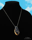 cut branch resin and wood teardrop phantom pendant on a 18 inch chain