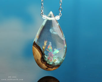 Opal terrarium teardrop pendant, resin and wood jewelry by cut branch