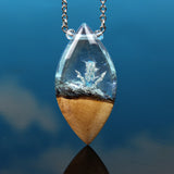 blue crystal phantom and silver crystal in resin and wood necklace
