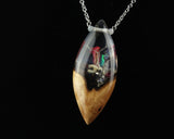 ocean alien life resin and wood necklace pendant